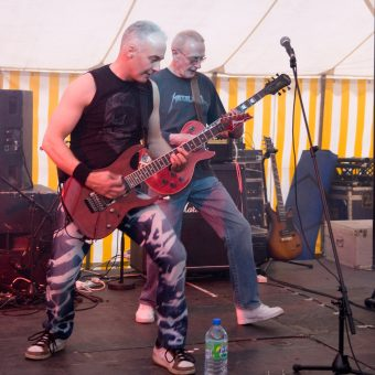 Neil and Rocker performing on stage.