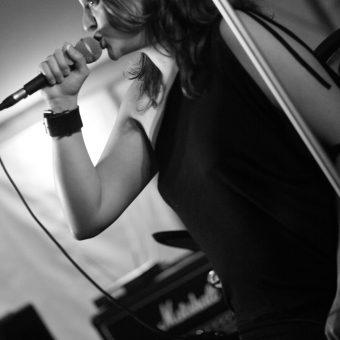 Ann singing, black and white.
