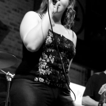 Ann singing, in black and white.