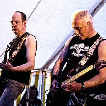Dave and Neil performing on stage.