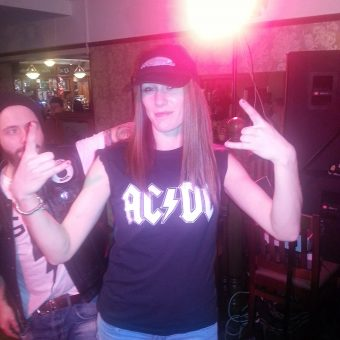 A girl (Caz) wearing a 5th Element cap and holding up a 5th Element demo CD.