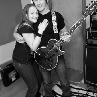 Ann and Neil hugging at the studio.