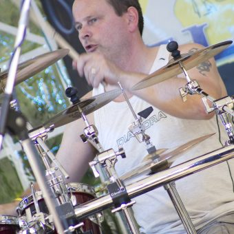 Close up of Phil drumming.