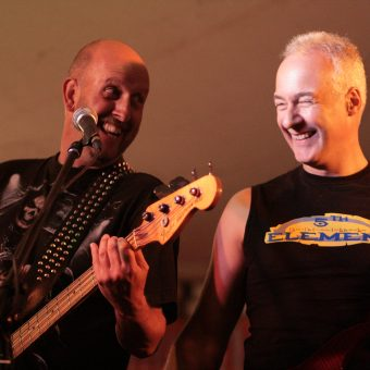 Richard and Neil laughing on stage.