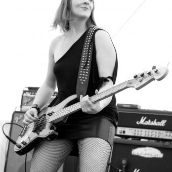 Ann playing bass, black and white.