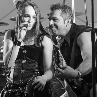 Ann and Alan performing on stage.