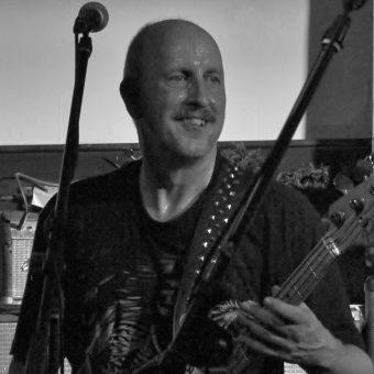 Richard smiling, black and white.