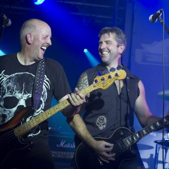 Richard and Alan playing on stage and laughing.