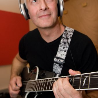 Close up of Neil playing in the studio.