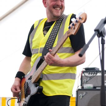 Richard smiling, wearing his 5th Element baseball cap and Hi Vis vest.