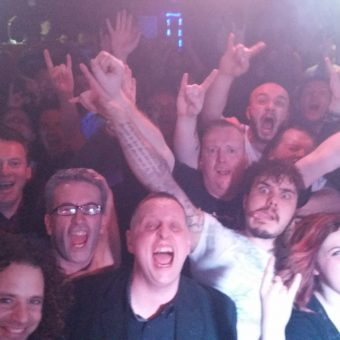 The crowd at Sanctuary Rock Bar, Burnley, cheering and waving their arms.