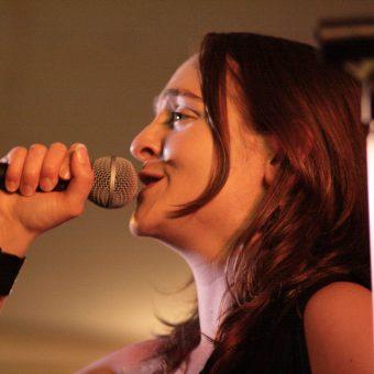 Close up of Ann singing.