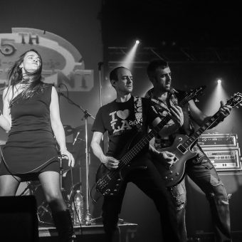 Ann, Dave and Alan performing on stage. Black and white.