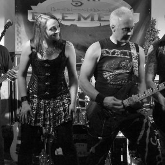 Richard, Ann, Neil and Alan performing on stage.