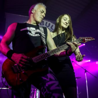 Neil and Ann performing on stage.