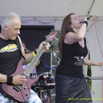 Ann and Neil performing on stage.
