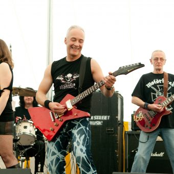 Ann, Neil and Rocker on stage.