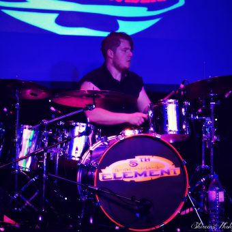 Aaron playing drums.