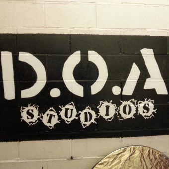 The black and white D.O.A. studios sign.
