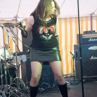 Ann head-banging on stage.
