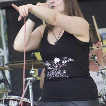 Ann singing and pointing at the crowd.