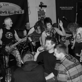 The crowd at the Plough, Chorley, dancing, with the band in the background. Black and white.