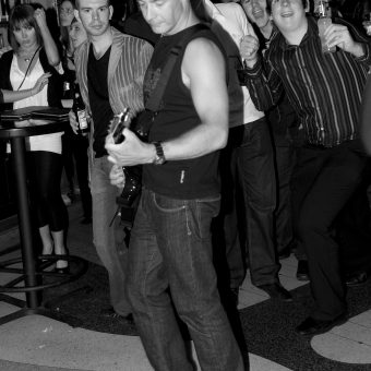 Neil out in the crowd, in black and white.