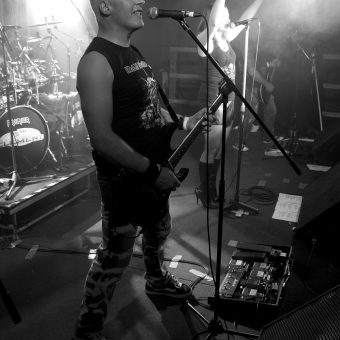 Neil singing on his mic, black and white.