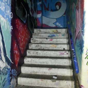 A stairwell at the studio, decorated with graffiti.