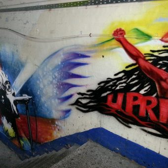 A mural graffiti design of the word 'uprising'.