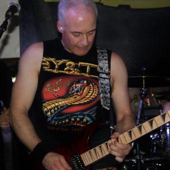 Neil playing guitar.
