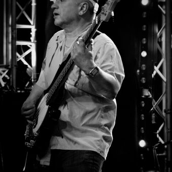 Pete dressed as a zombie, playing bass. Black and white.