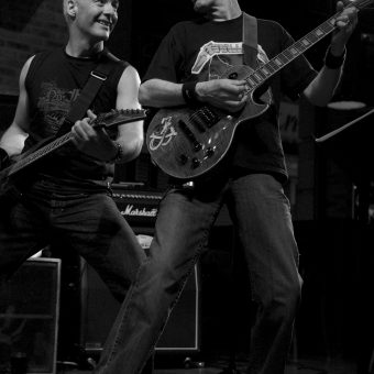 Neil and Rocker smiling at each other, in black and white.