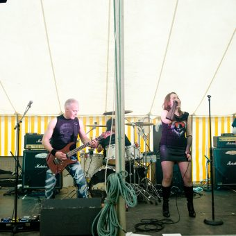 The band performing on stage.