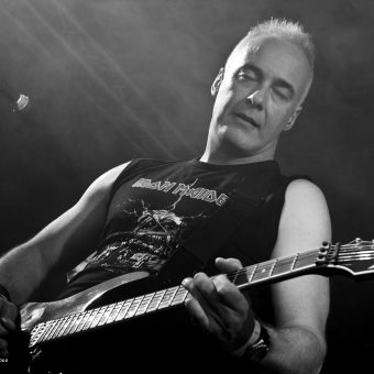 Neil playing guitar, black and white.