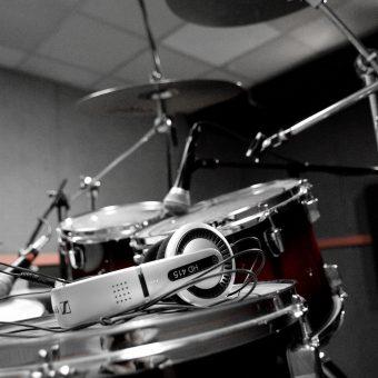 The drum kit with headphones.