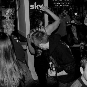 The crowd at the Plough, Chorley, dancing. Black and white.
