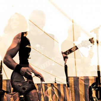 The band playing, multi-layered effect, sepia.