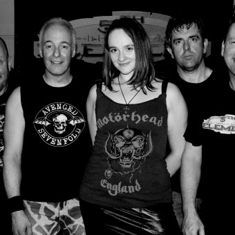 Richard, Neil, Ann, Alan and Phil posing for a group photo. Black and white.