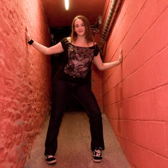 Ann in a red corridor at the studio.