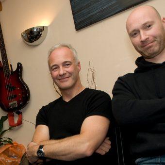 Neil Hughes and Neil Treppas in the studio, smiling.