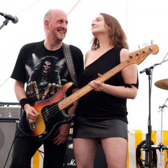 Ann helping Richard play his bass.