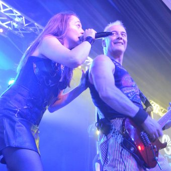 Ann and Neil performing on stage together.