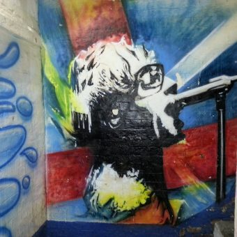 A mural graffiti design of a rock singer.