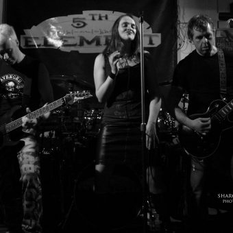 The band performing, black and white.