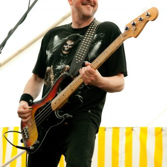 Richard playing bass and smiling.