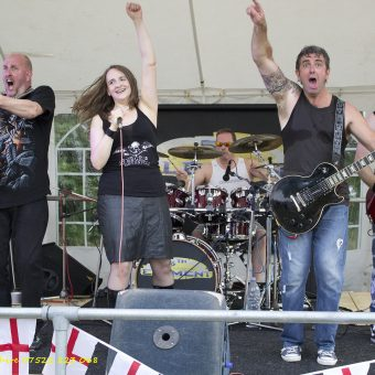 The band bouncing on stage.