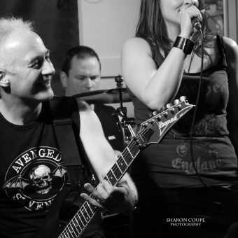 Neil and Ann performing, black and white.