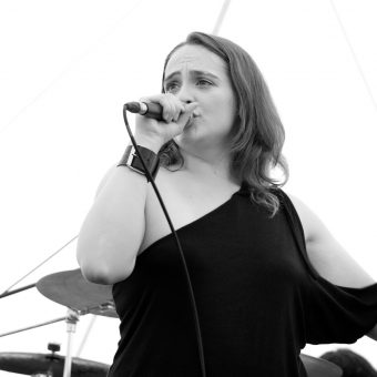 Ann singing, black and white.
