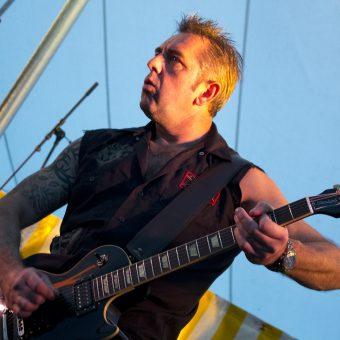 Alan playing guitar.